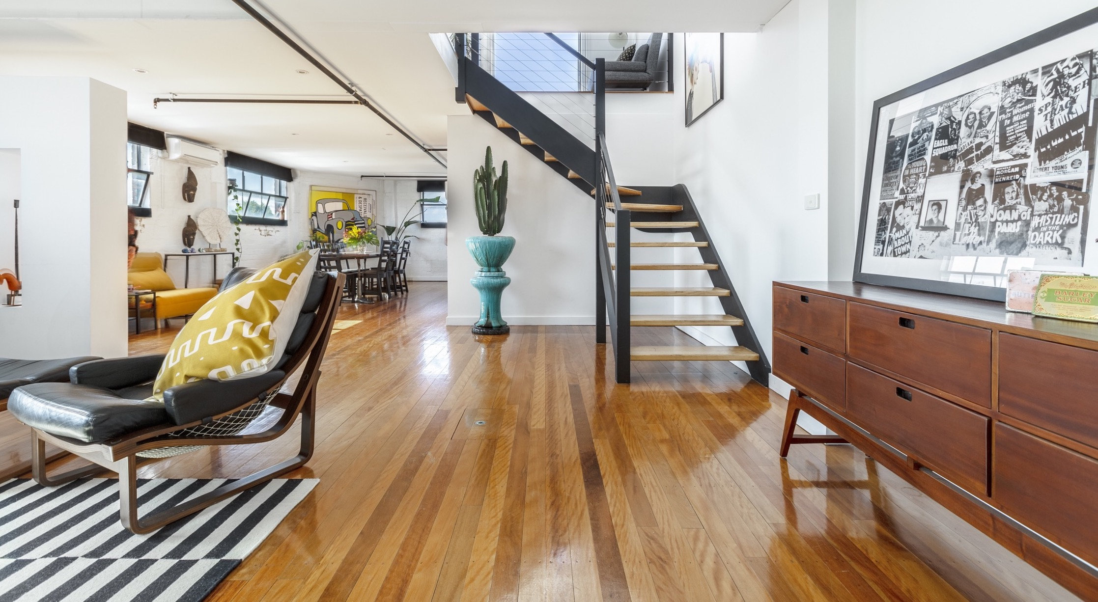 Serviced-apartment-Fitzroy-living-area-and-stairs